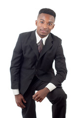 young businessman standing in suit and tie