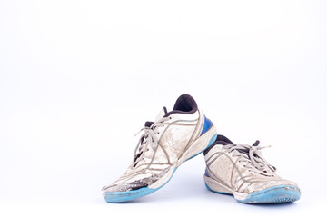 Old used  blue worn out futsal sports shoes  on white background  football isolated