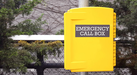 Yellow emergency call box in New York for assistance in case of