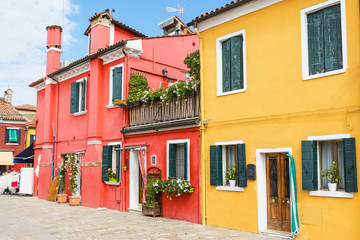 Red and yellow houses in Burano Island (Venice, Italy). All potential trademarks are removed.