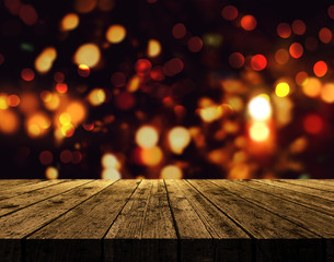 3D Christmas background with wooden table and bokeh lights