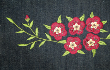 Embroider flower on jeans fabric background