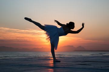 Ballet dancer sulhouette at sunset.