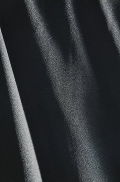 black fabric in shadow background and texture
