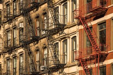 Soho building facades with fire escapes. Manhattan, New York City