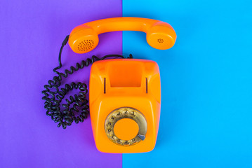 Orange phone on a bright background