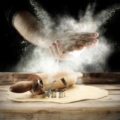 men hands and flour splash