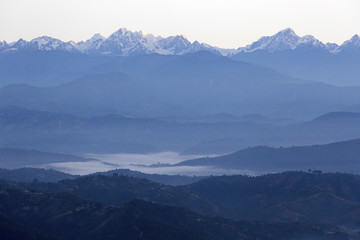 Wall Murals Nepal A view of the sun rising over the Himalayas from Dhulikhel, Nepal