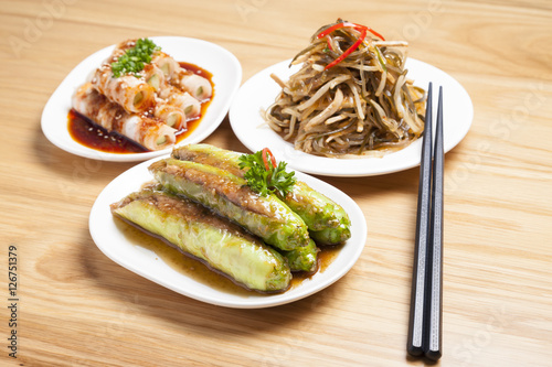 Various type of chinese food and chopsticks on table for 8 types of chinese cuisine