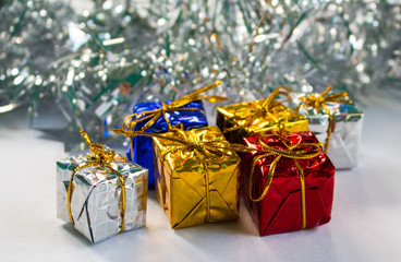 Christmas presents. Red, blue, silver and gold gift wrapping.