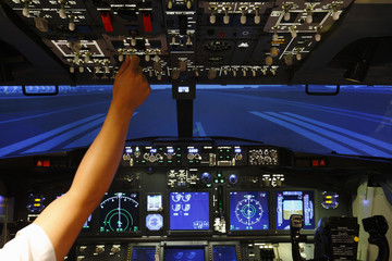Hand control in cockpit of airplane in flight simulator