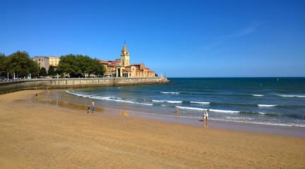 View of San Pedro church at San Lorenzo beach in Gijon, Asturias, Spain