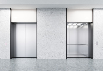 Two closed and open elevators in corridor with concrete walls
