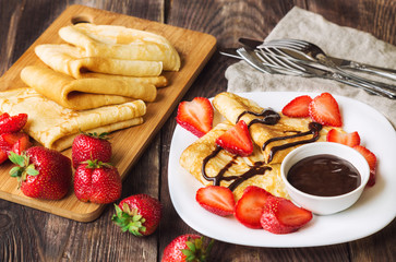 Fresh homemade crepes with strawberries and chocolate sauce