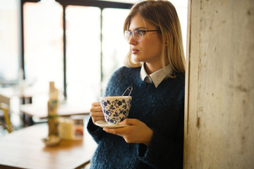Attractive woman drinking coffee