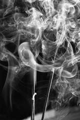 Grey smoke from aromas incense