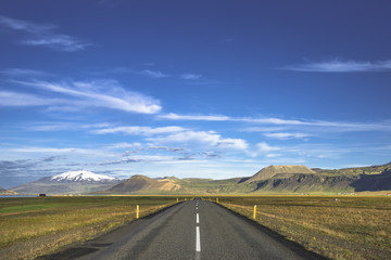 Isolated road to Snaefellsjoekull mountain at Iceland, summer ti