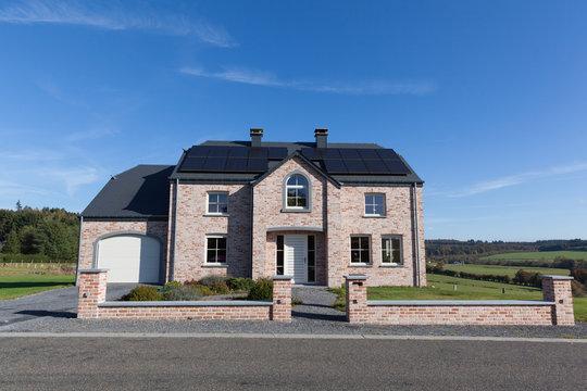 Modern house with solar panels for alternative energy