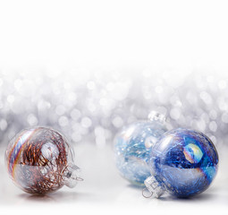 Silver and Blue Christmas ornaments balls on glitter bokeh background with space for text. Xmas and Happy New Year theme
