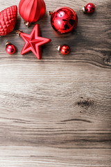 Red Christmas ornaments on a rustic wooden background. Xmas card. Happy New Year. Top view with copy space