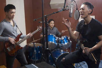 Musical band in recording studio