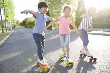 Happy children skateboarding