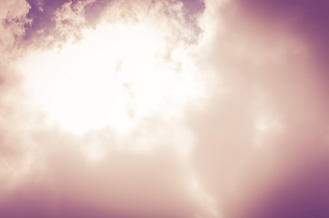 Looking up at sky with sun beam with cloudy,Vintage filter