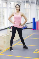 Portrait of young woman at gym