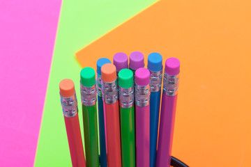 Colorful pencils and poster board