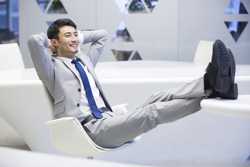 Young businessman resting in office