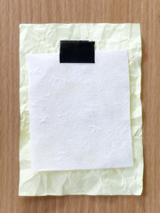 Yellow notepad paper crumpled of empty and copy space on wooden