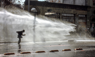 Student's March, police used water cannon against the student protesters in Chile.