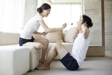 Young couple exercising at home