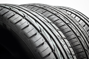 Car tires background in a row on white background. rubber