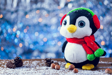 Cute Happy Penguin Christmas Toy Smiling On Snowy Wood