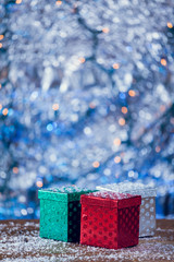 Small Colorful Christmas Gift Boxes On Snowy Wood