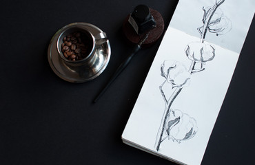 notebook, ink bottle, ink pen, dark background,dried cottonbrunch with flowers