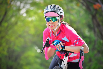 Woman ride bike at park, healthy lifestyle concept and sport motivation idea