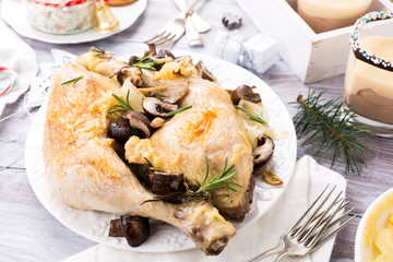 Delicious Christmas themed dinner table with roasted chicken, appetizers and desserts. Holiday concept.