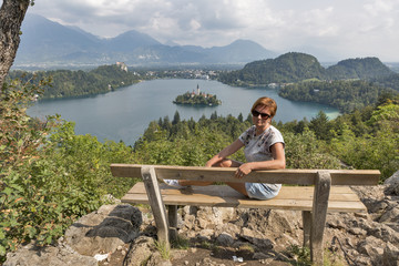 White woman and lake Bled view from above in Slovenia