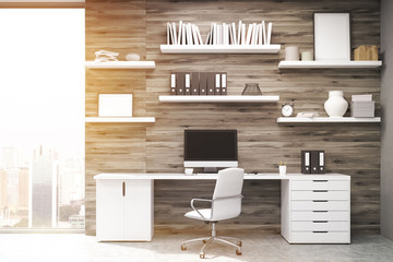 Home office with dark wood panels, toned
