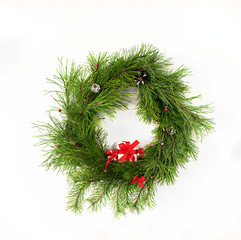 christmas wreath with red ribbon and gift box