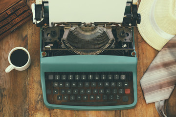 top view photo of vintage typewriter with blank page