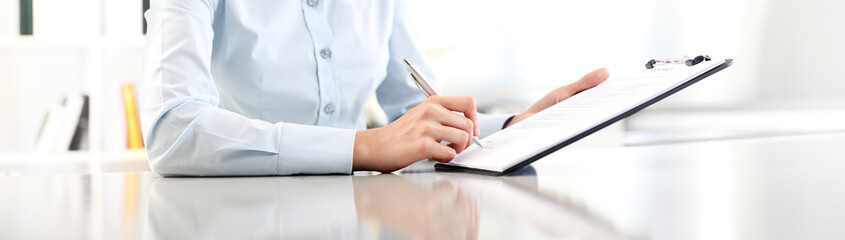 woman hands writing on clipboard with a pen, isolated on desk panoramic