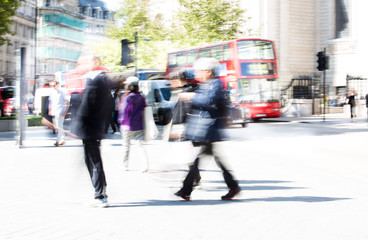 Business people blur. People walking in the City of London, business and financial aria