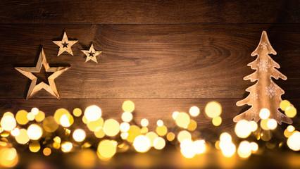 Weihnachten Hintergrund aus Holz und Lichtern, fröhlich und kontrastreich