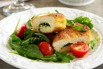 Chicken cutlet with a salad with arugula