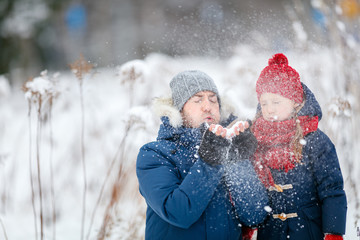 Father and daughter outdoors at winter