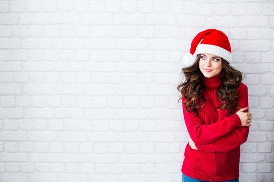 Portrait of woman in Santa's hat.