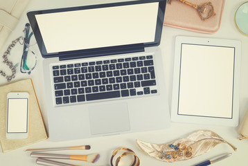 Laptop, tablet and phone with golden woman accessories mock up flat lay styled scene, top view, copy space on blank screen background, retro toned